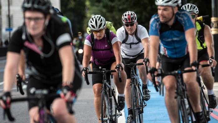 LONDON, ENGLAND - AUGUST 24: Cyclists pass along a cycle superhighway on August 24, 2017 in London, England. Cycling in London is a popular mode of transport and leisure activity within the British capital and numbers have increased in recent years. (Photo by Carl Court/Getty Images)