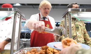 Boris Johnson serves Christmas lunch to British troops stationed in Estonia.
