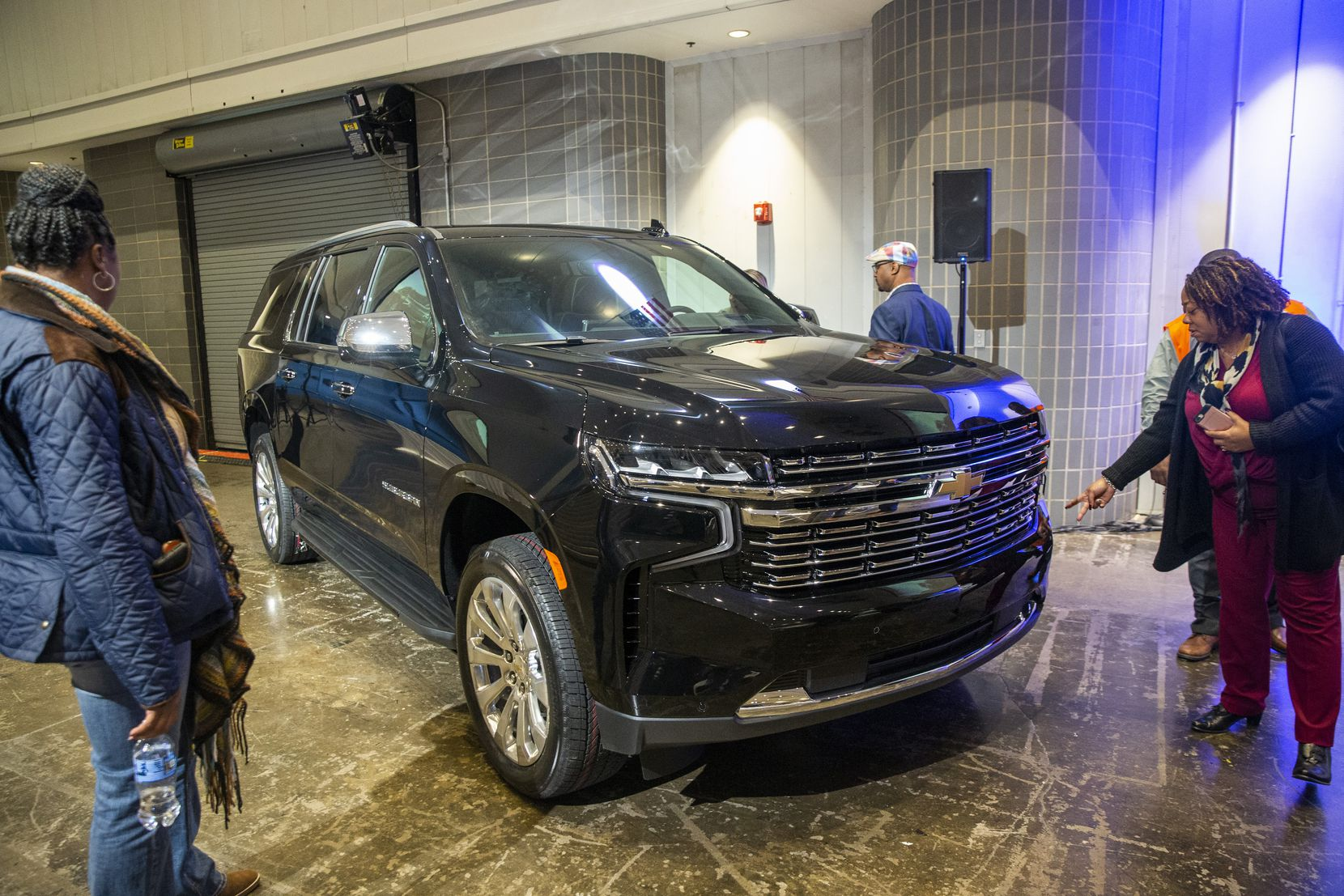 Attendees survey the new Chevrolet Suburban during the unveiling event of the next-generation models of the Chevy Suburban and Tahoe at the General Motors Assembly Plant in Arlington, Texas, on Tuesday, Dec. 10, 2019. (Lynda M. Gonzalez/The Dallas Morning News) ORG XMIT: 20048667B