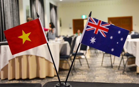 Australian and Vietnamese flags on table