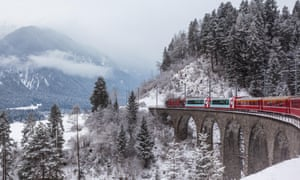 Famous sightseeing train running over viaduct in Switzerland, the Glacier Express in winterG0TX2B Famous sightseeing train running over viaduct in Switzerland, the Glacier Express in winter