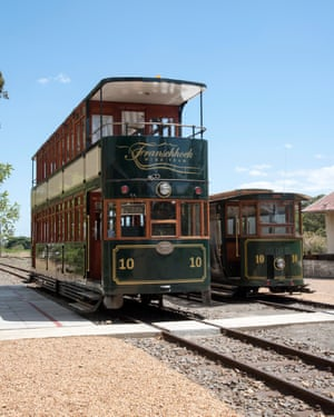 Two sightseeing wine trams at the old railway station.