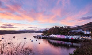 Pink light at Portree harbour during a Winter sunset. Isle of Skye, western Scotland.