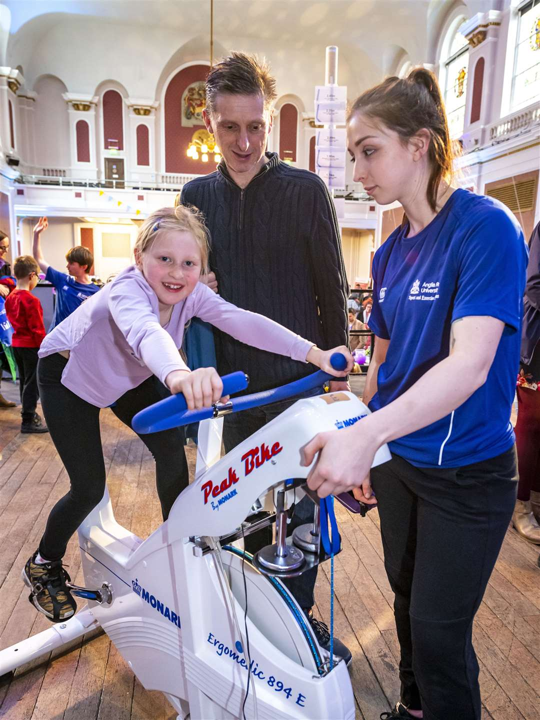 Cambridge Science Festival activities in the Guildhall, trying a bit of sports science from left Rose Chinn with father Russell Chinn and Alicia Diment ARU sports science student. Picture: Keith Heppell. (27219808)