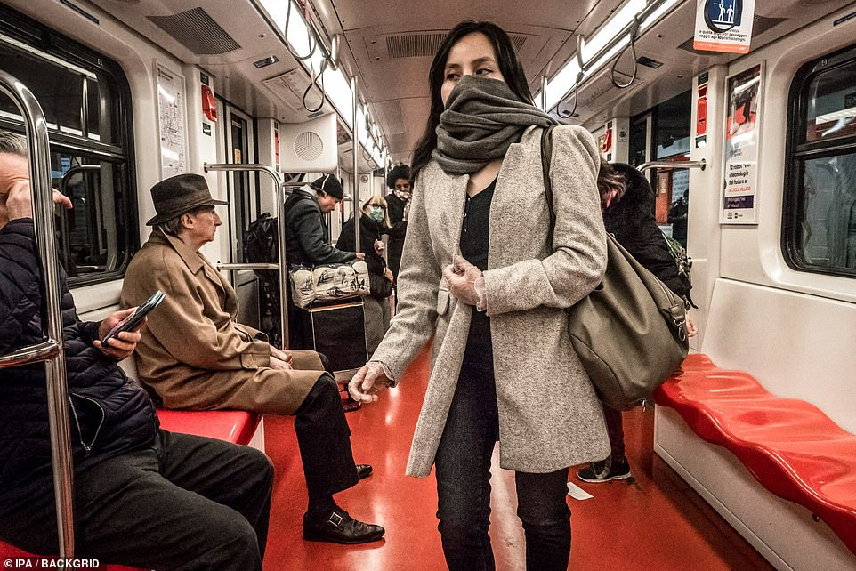 Passengers on an underground train in Milan wear face masks to protect themselves from the COVID19 coronavirus