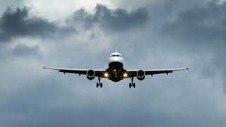 Plane landing at Heathrow Airport