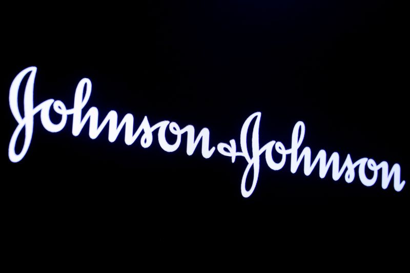 © Reuters. FILE PHOTO: The company logo for Johnson & Johnson is displayed on a screen to celebrate the 75th anniversary of the company's listing at the NYSE in New York