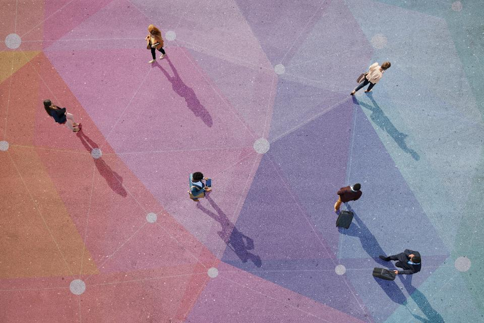Top view of people walking in different directions of pattern, painted on asphalt