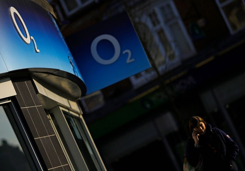 © Reuters. A woman speaks on her mobile telephone outside an O2 shop in Loughborough
