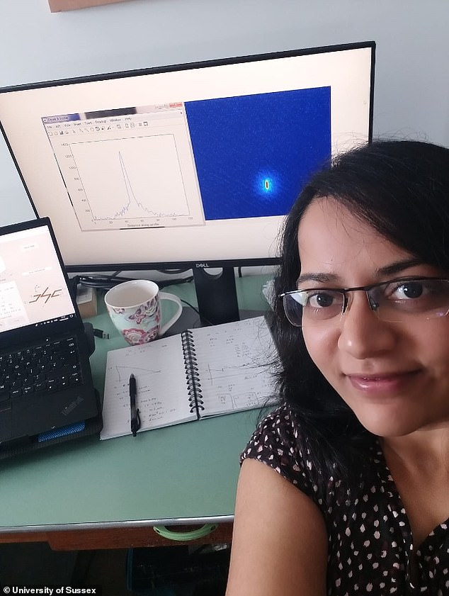 Dr Amruta Gadge working from home, around two miles from the University of Sussex lab, with an image of the BEC on her screen
