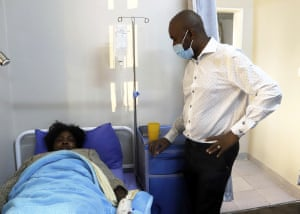 Nelson Chamisa, the Zimbabwean opposition leader, visits an activist at a local hospital in Harare last Friday, after she went missing and reappeared.